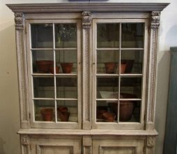 A painted glazed bookcase