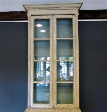 A French provincial painted bookcase cabinet