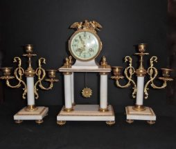 A Louis XVI Style Ormolu Mounted Marble Three Piece Clock Set