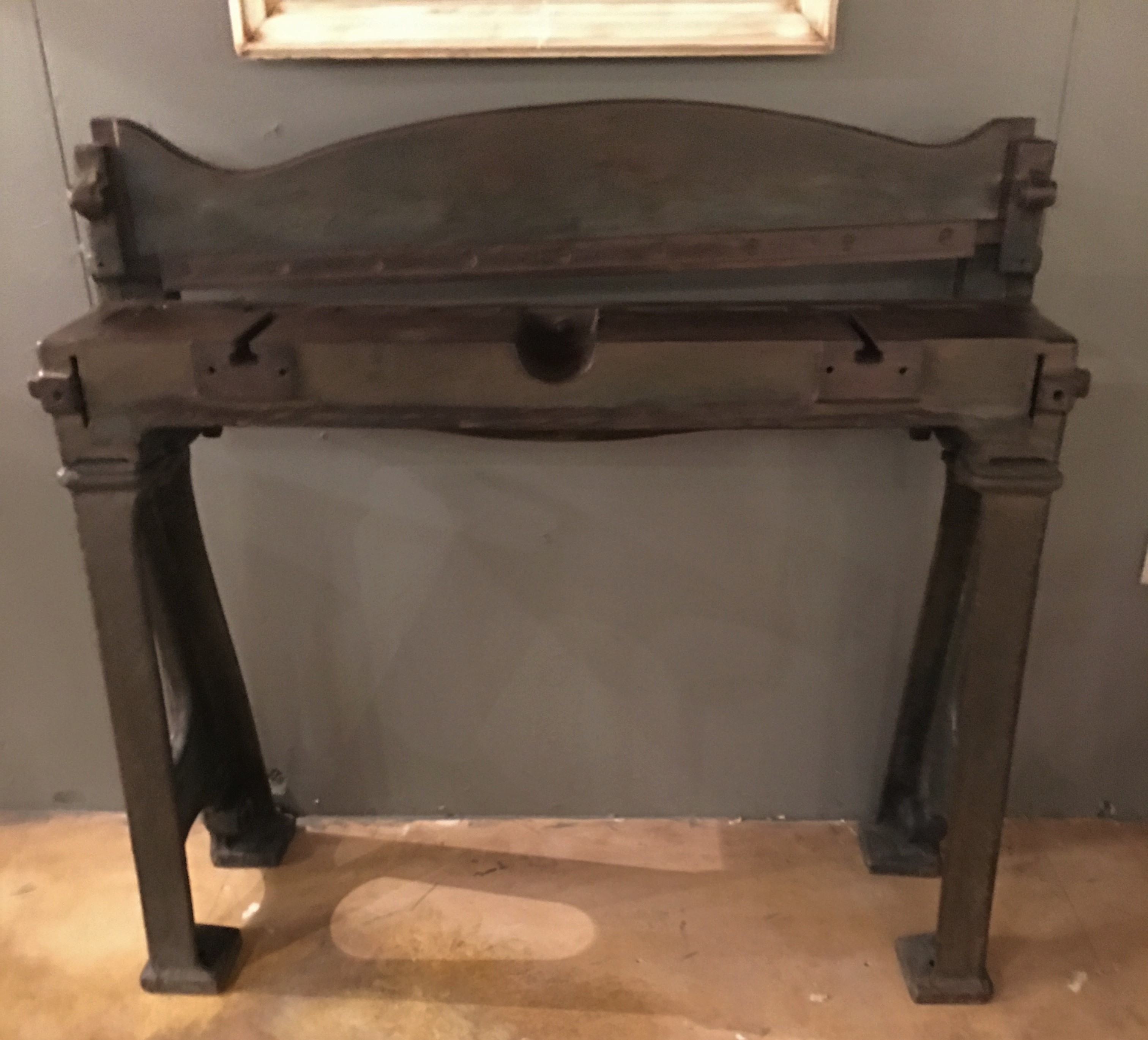 an industrial guillotine console table interior
