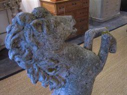 A prancing horse stone garden statue