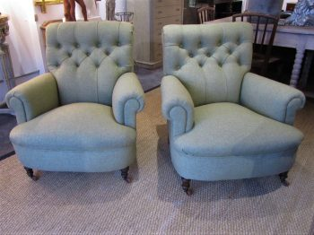A pair of country house armchairs