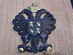 A carved wood coat of arms