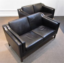 A pair of Danish black leather sofas