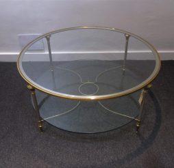 A circular Maison Jansen coffee table