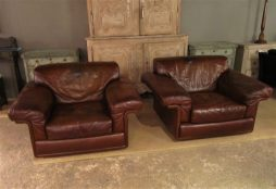 a pair of de sede leather armchairs