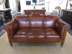 A Swedish double drop arm club leather sofa