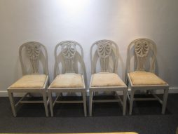 A set of 8 19thC painted dining chairs