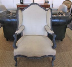 A very large wing back Bergere wing armchair