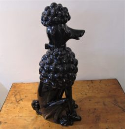 A ceramic black glazed poodle