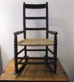AN English folk art provincial rocking chair