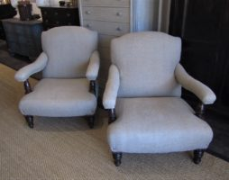 A pair of English Country House open Armchairs