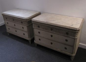 A large pair of Swedish painted commodes