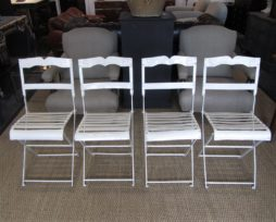 A Set of four folding wrought iron bandstand chairs