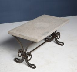A mid century wrought iron coffee table
