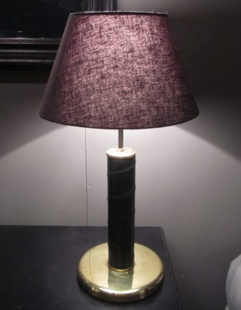 A pair of leather bound brass table lamps