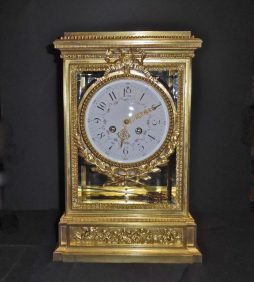 A Fine Antique Louis XVI Style Ormolu and Glass Mantel Clock