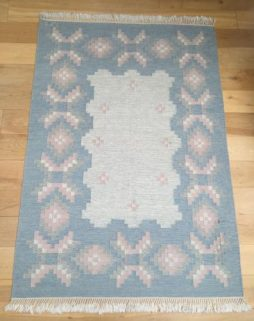 Handwoven flat weave rug with initials MJ