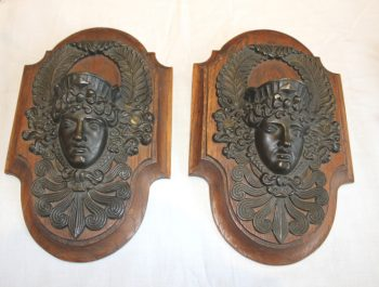 A pair of late 19th century bronze masks