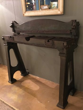 An Industrial guillotine console table