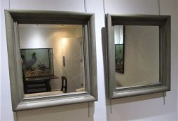 A pair of wood framed mirrors