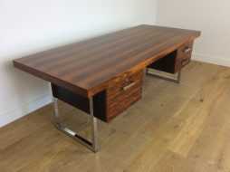 MID CENTURY ROSEWOOD AND CHROME EXECUTIVE DESK by GORDON RUSSELL