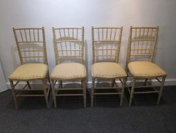 A set of four faux bamboo sidechairs