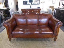 A Swedish double drop arm club leather sofa