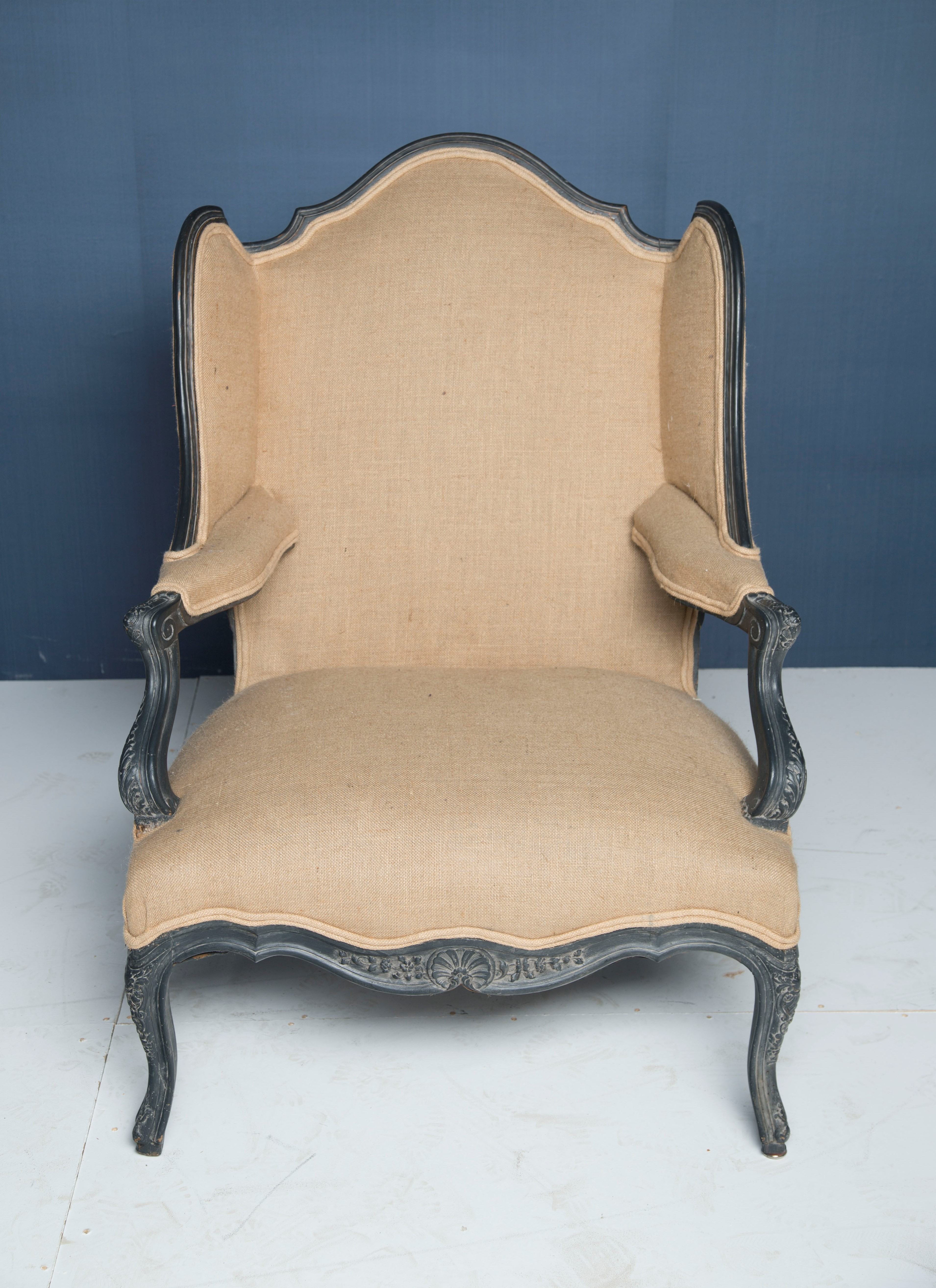 A Very Large Wing Back Bergere Armchair