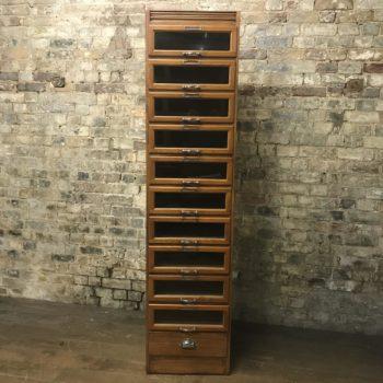 Single oak haberdashery cabinet