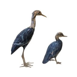 A 1970's Heron and Duck figurine with silver plated and and legs