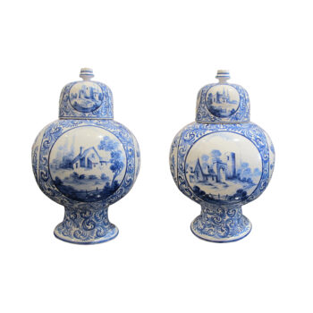 A pair of late 19th Century Dutch Delft vases with lids